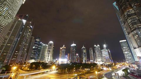 timelapse,urban traffic & walking people silhouette at night,modern skyscrap Animation