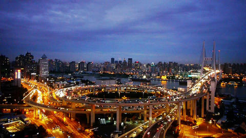 Aerial view of shanghai overpass traffic at night,urban... Stock Video Footage