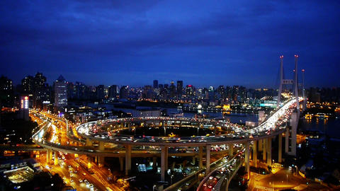 Aerial view of urban overpass traffic at night,city blue... Stock Video Footage