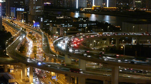 closeup of urban traffic on overpass interchange at night,time lapse Animation