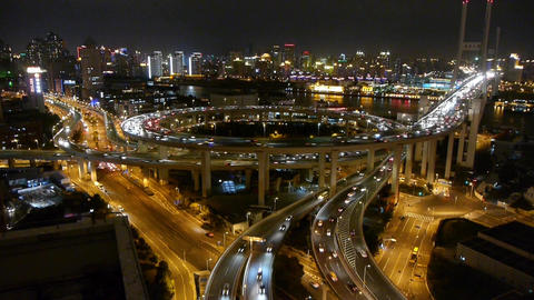time lapse,fast cars on overpass interchange,Brightly lit urban building Animation