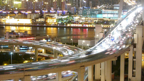 time lapse fast cars on overpass bridge,urban building... Stock Video Footage
