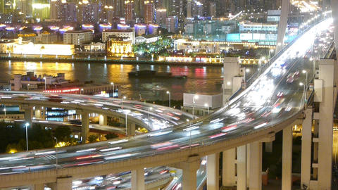 time lapse fast cars on overpass bridge,urban building & shipping on river Animation