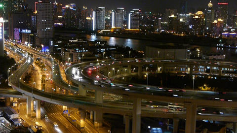 busy urban traffic on overpass bridge at night,shipping... Stock Video Footage