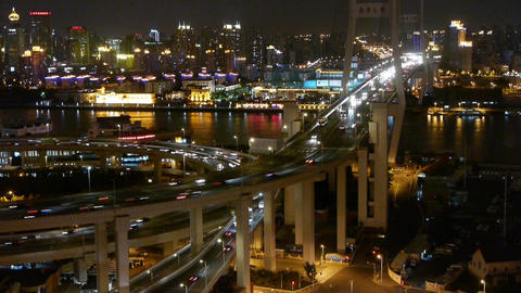 busy urban traffic on shanghai overpass bridge at night,shipping on river Animation