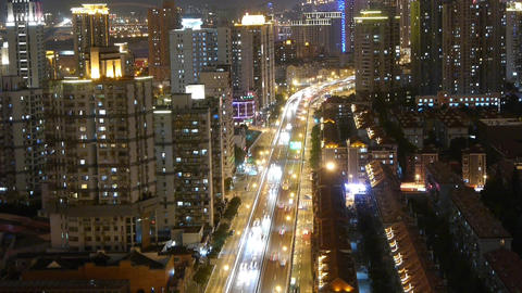 busy urban traffic with streaking lights trail at night,shanghai china Animation