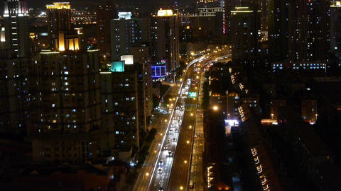 busy urban traffic jam at night,Brightly lit urban morden building background Animation