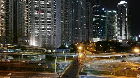 urban traffic & Brightly lit skyscraper at night,fast... Stock Video Footage
