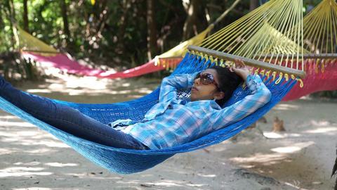 Woman relaxing in a Hammock Stock Video Footage