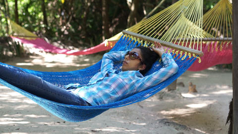 Woman relaxing in a Hammock Footage