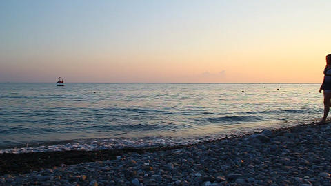 Young beautiful girl walking on the beach at sunse Stock Video Footage