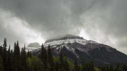 Time lapse of violent clouds on top of mountain Stock Video Footage