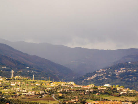 Village in mountain valley fog hides. Sicily, Ital Stock Video Footage