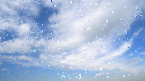 drops of rain and blue cloudy sky Footage