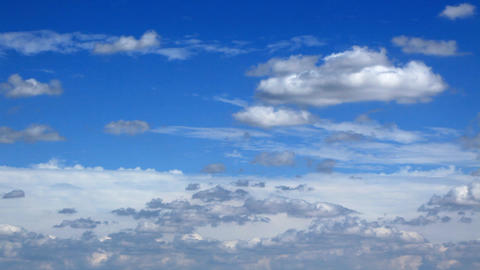 white fluffy clouds over blue sky Footage