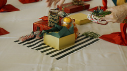 Arranging Christmas Decorations for a Table Center Stock Video Footage