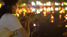 Thai Man Praying Before Releasing a Krathong Durin Footage
