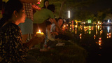 Young Thai Woman Floating A Krathong During Loi Kr stock footage