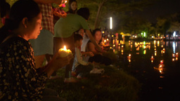 Young Thai Woman Floating a Krathong During Loi Kr Stock Video Footage