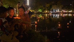 Young Thai Man Release a Krathong into a Pond in B Stock Video Footage