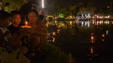 Young Thai Man Release a Krathong into a Pond in B Footage