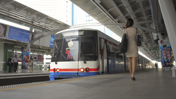 Train Departing from Skytrain Station in Bangkok Stock Video Footage