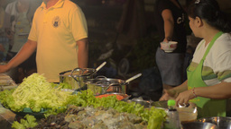 Thai Street Vendor Preparing to Make Som Tum Stock Video Footage