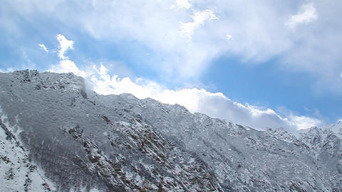 Beautiful white clouds illuminated by the sun flyi Stock Video Footage