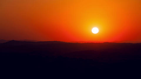 Vibrant Sunrise behind the Mountain, timelapse, 4K Stock Video Footage