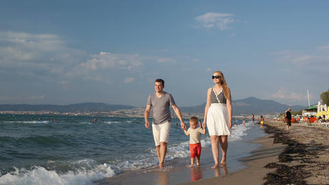 Young family walking on the beach Stock Video Footage
