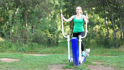 Woman exercising on a trainer Stock Video Footage