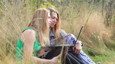 Female friends with laptop outdoor Footage