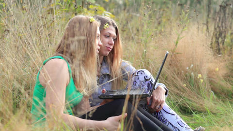 Female friends with laptop outdoor Stock Video Footage