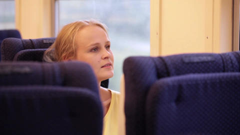 Smiling woman in the train Stock Video Footage