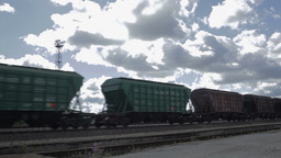 The freight train is passing by on a sunny day Footage