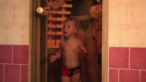 Mother and her son leaving sauna Stock Video Footage
