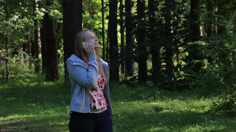 Woman talking on the phone in the park Stock Video Footage