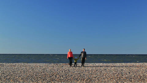 Young parents with their young child on a beach Stock Video Footage