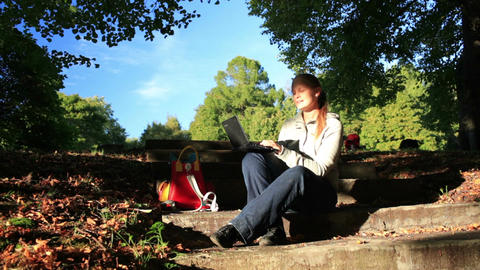 Young woman working outdoors on a laptop Stock Video Footage