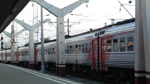 Train passing by the railway station Stock Video Footage