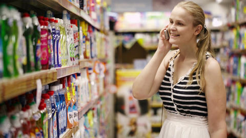 Woman chatting on her mobile while out shopping Stock Video Footage