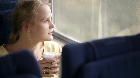 Pensive married woman traveling by train Stock Video Footage