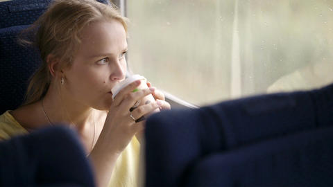 Pensive married woman traveling by train Live Action