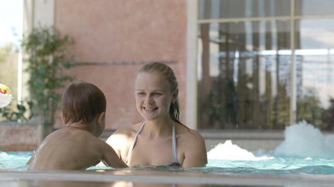 Mother and her son in the swimming pool Footage