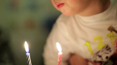 Little boy blowing out the candles Stock Video Footage