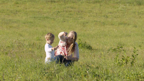 Mother and son on green grass Footage