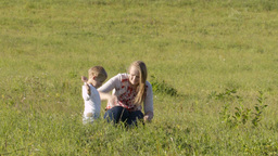 Mother and son on green grass Stock Video Footage