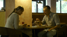 Young couple in a cafe Stock Video Footage
