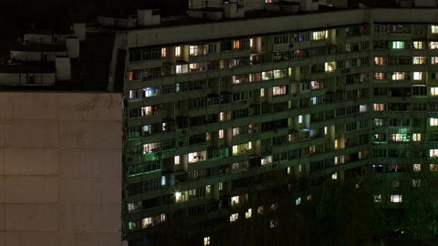 Time lapse windows of building at night Stock Video Footage