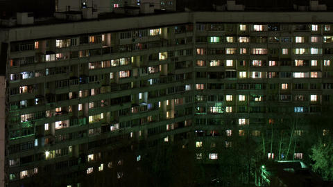 Time lapse windows of building at night Footage